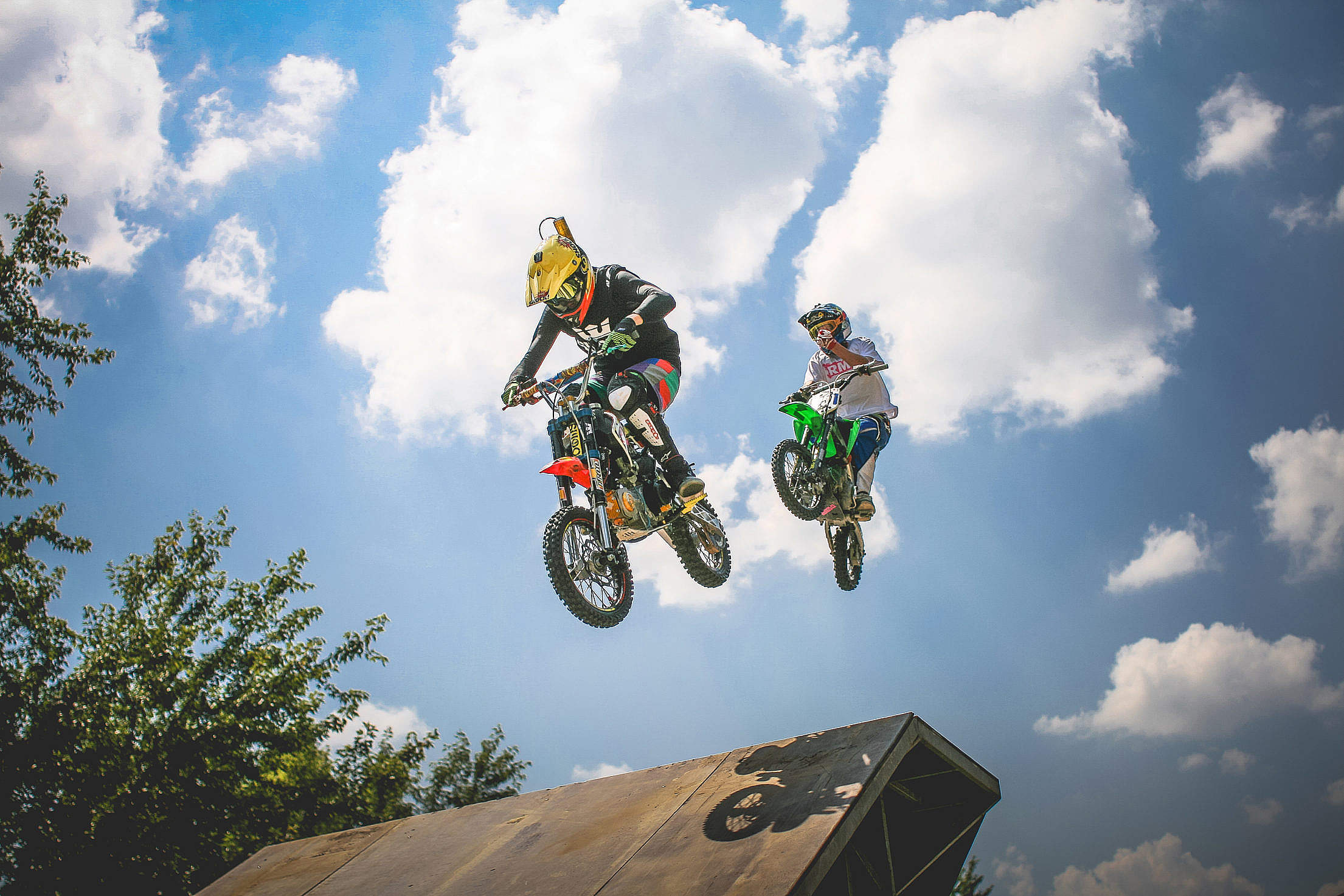 Two Crazy Jumping Pitbikers Free Stock Photo