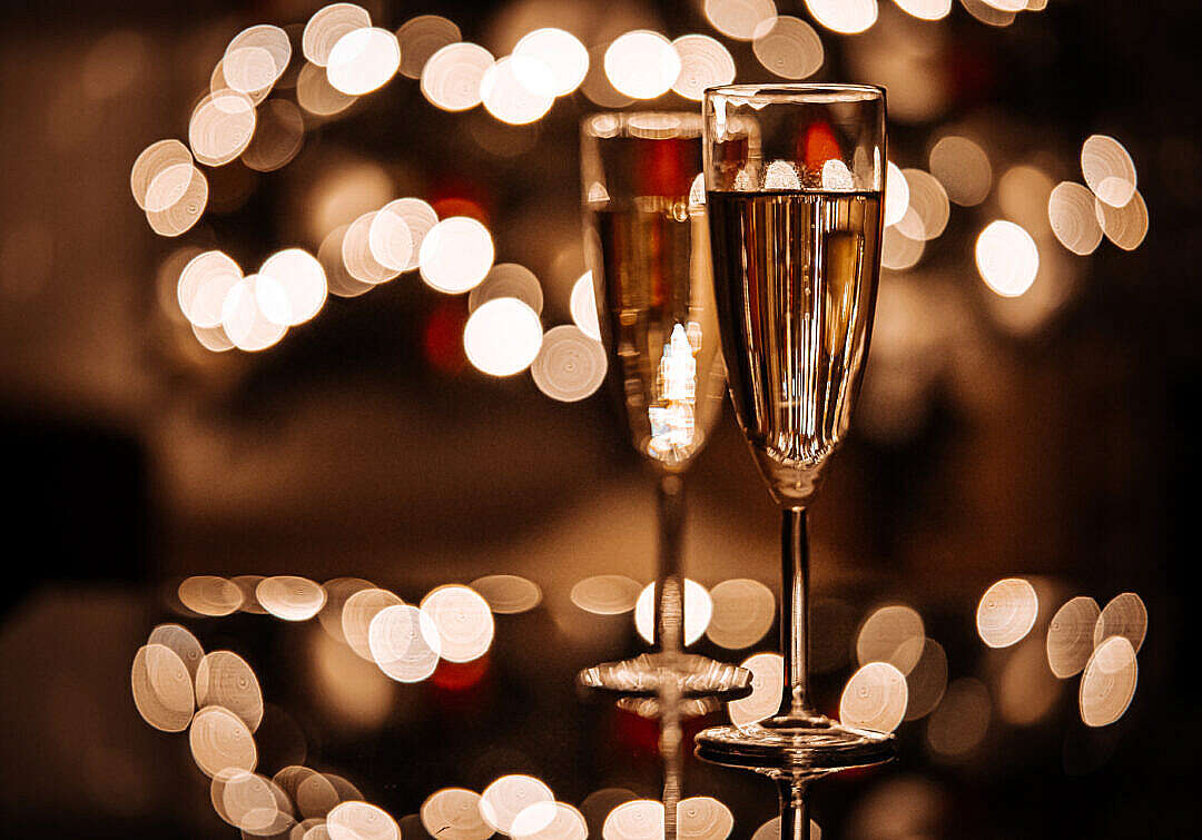 Download Two Glasses with Champagne on Glass Table FREE Stock Photo