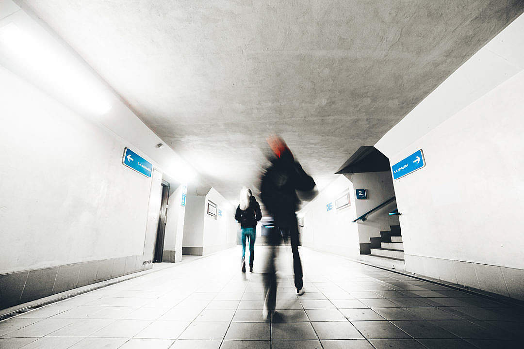 Download Two People Go Through The Underpass FREE Stock Photo