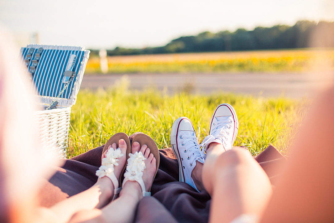 Download Two Young Girls Enjoying Their Roadtrip Picnic FREE Stock Photo