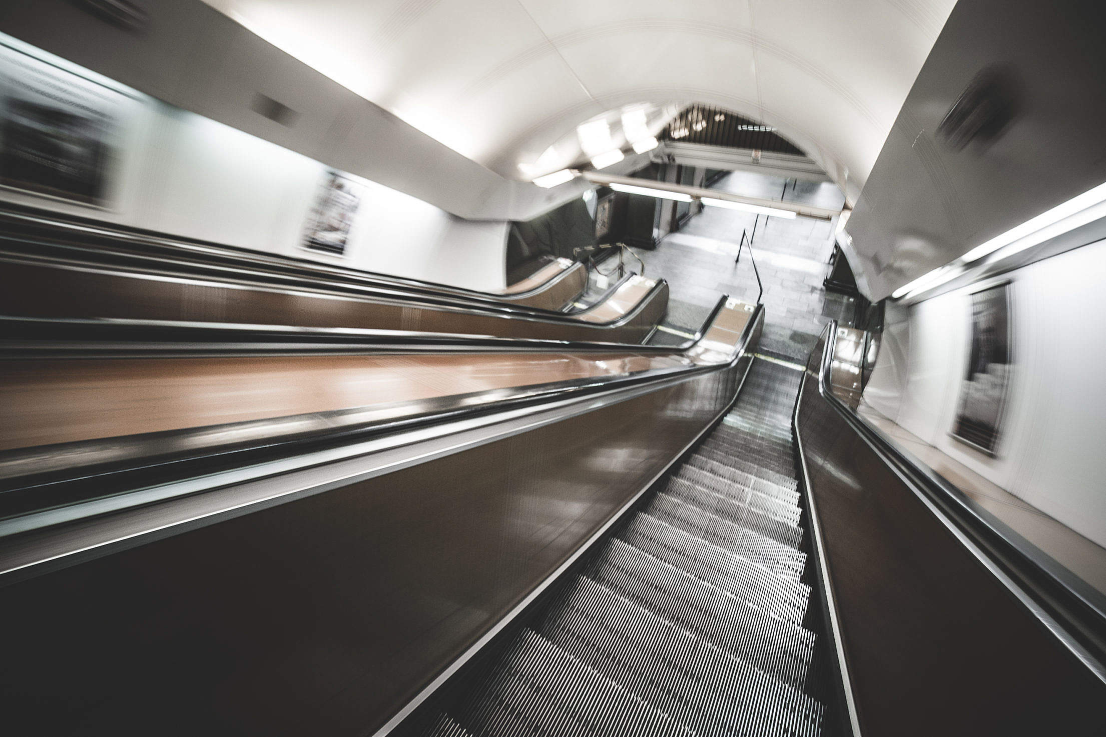 Underground Escalator in Motion Free Stock Photo