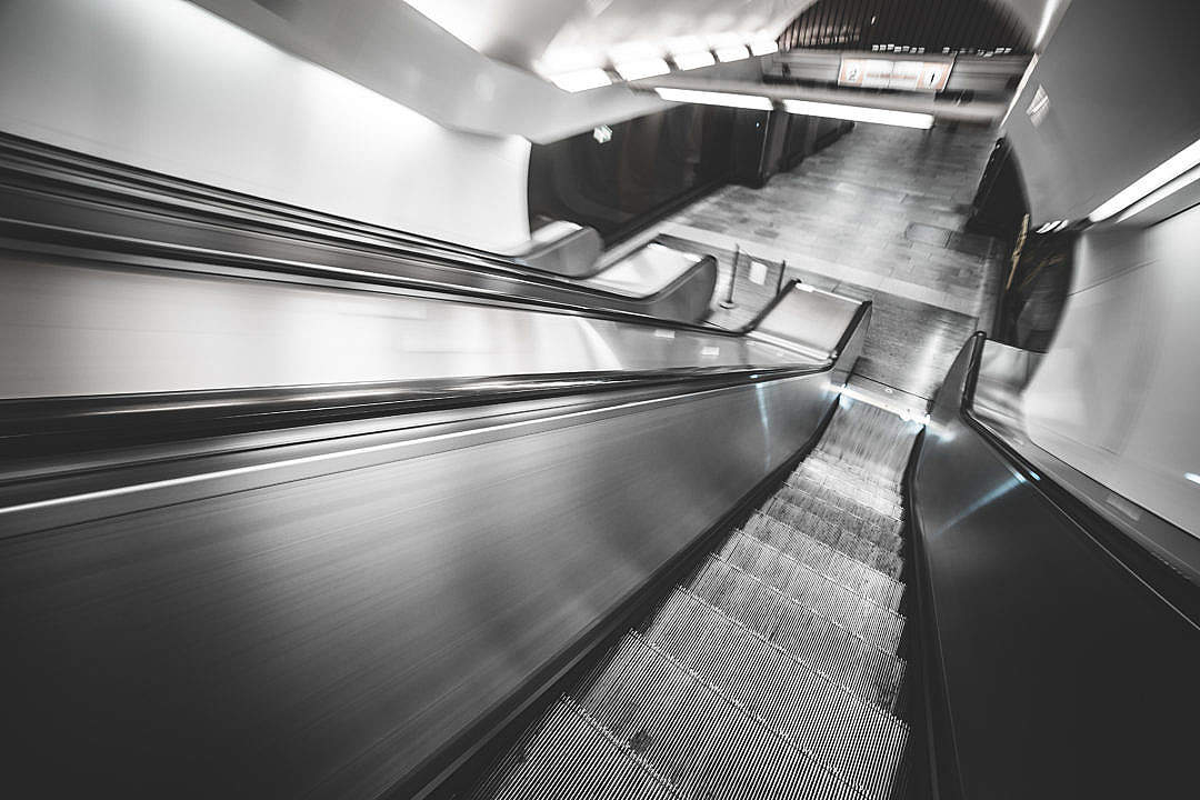 Download Underground Subway Escalator in Hypnotic Motion FREE Stock Photo