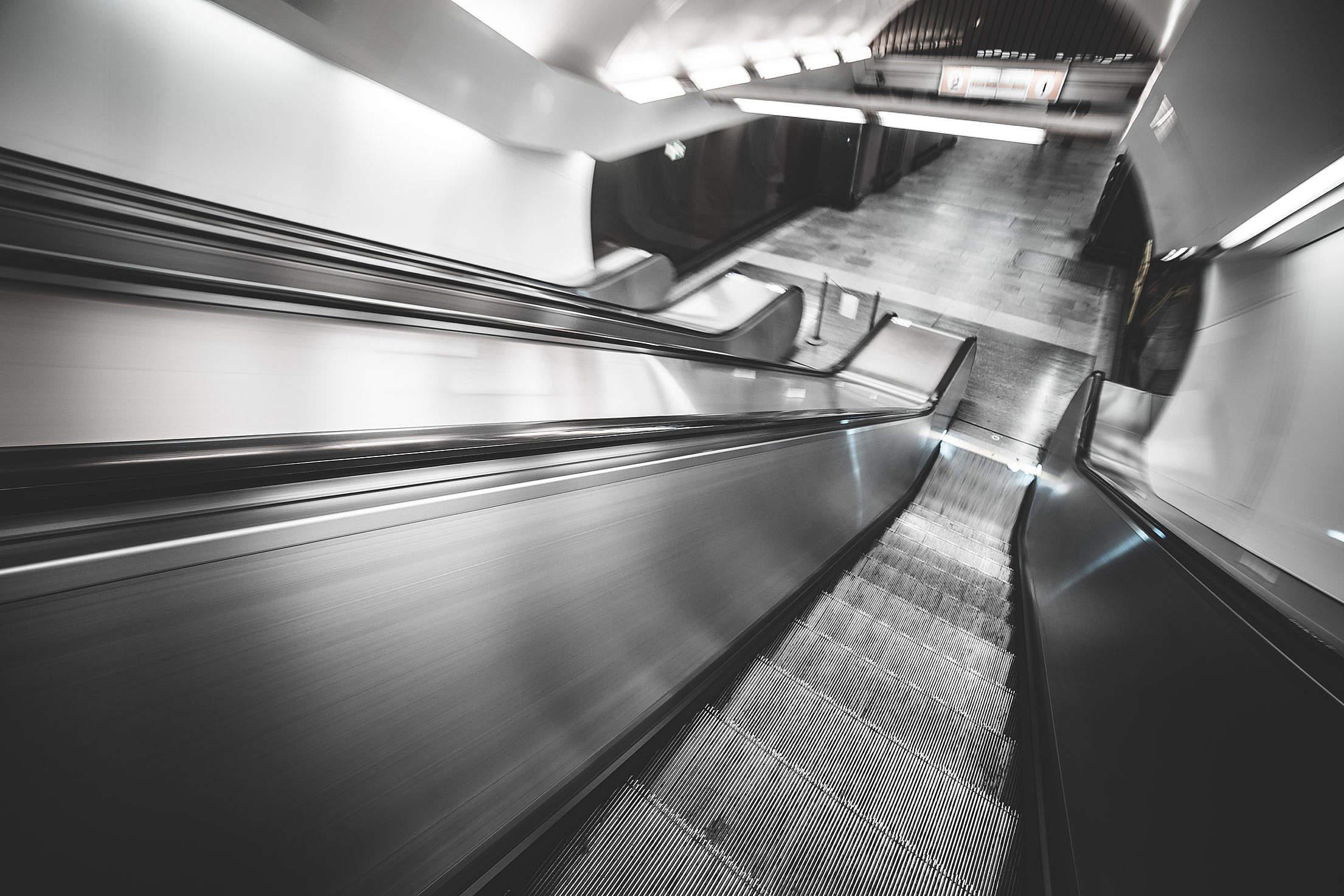 Underground Subway Escalator in Hypnotic Motion Free Stock Photo