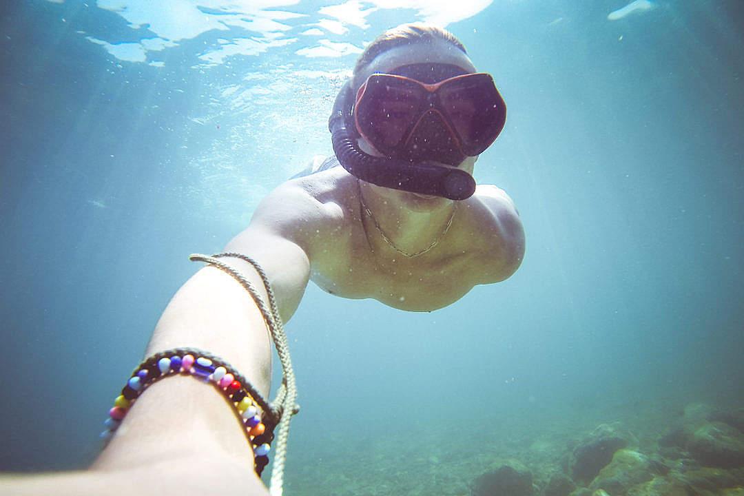 Download Underwater Diving/Snorkeling Selfie in The Sea FREE Stock Photo