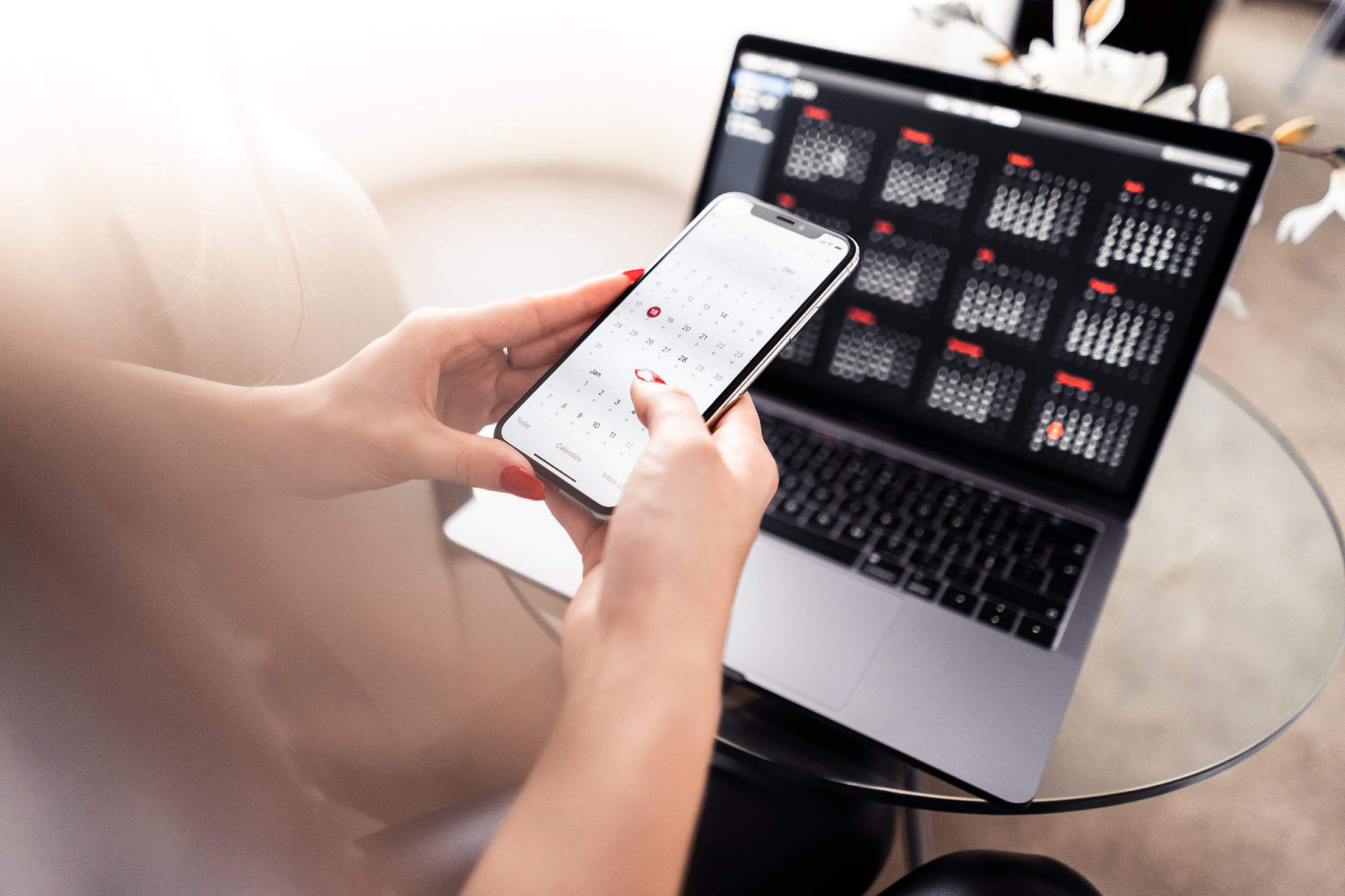 Using Calendar on iPhone XS and MacBook Pro Free Stock Photo