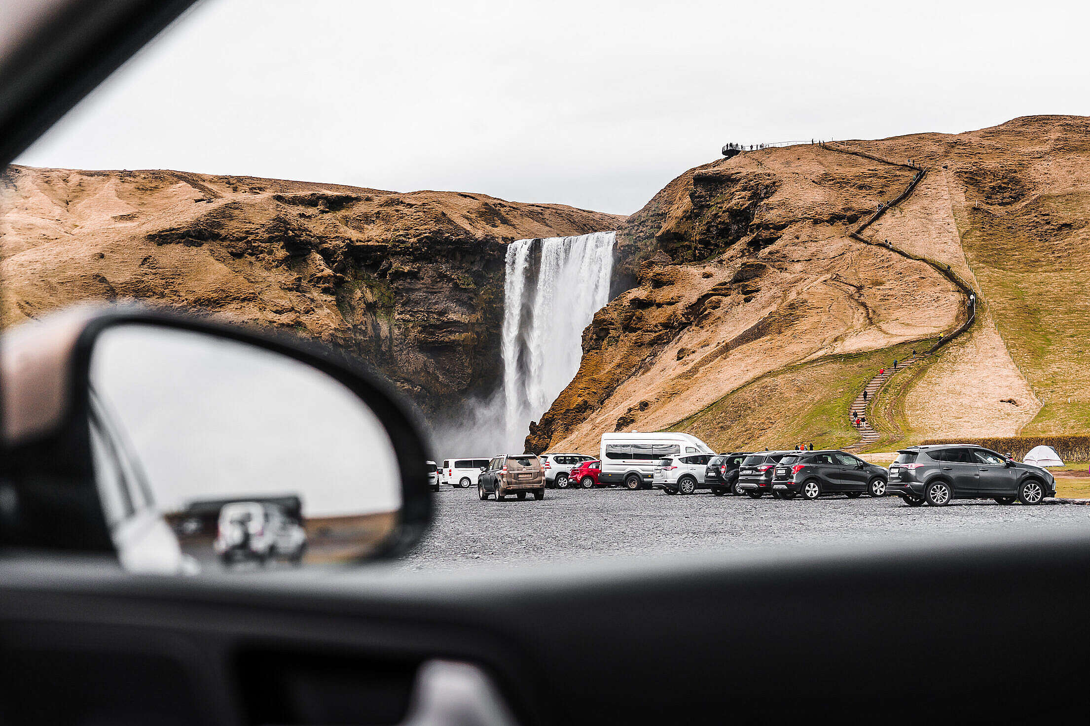 View from a Car to Skógafoss Waterfall Free Stock Photo