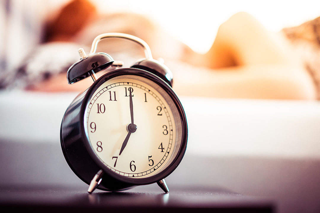 Download Vintage Alarm Clock and Sleeping Woman FREE Stock Photo
