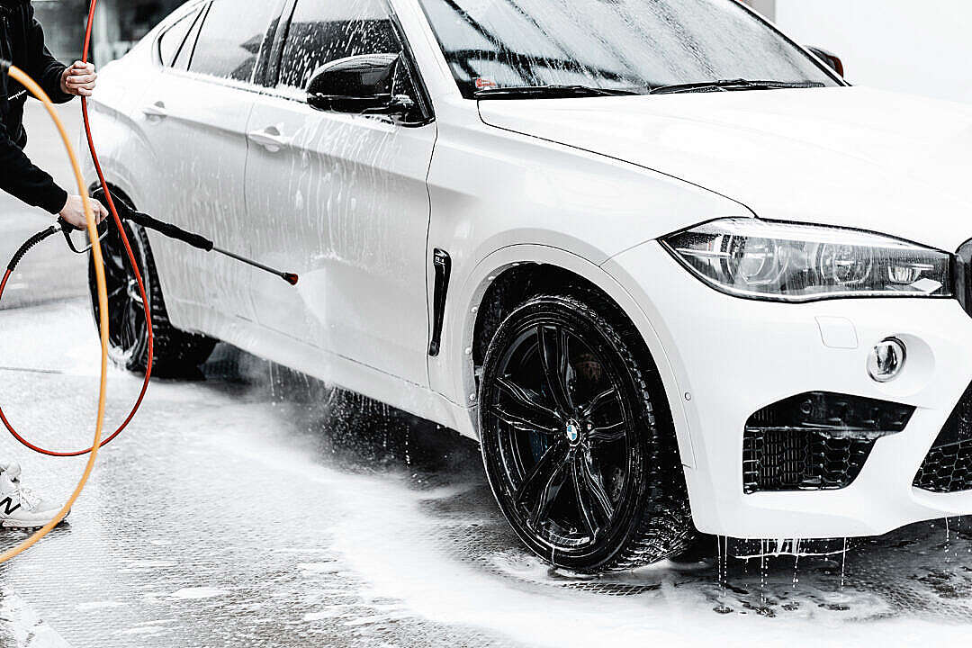 Download Washing White SUV in Self Service Car Wash with a Wap Hose FREE Stock Photo