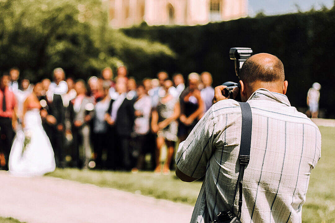 Download Wedding Photographer in Action FREE Stock Photo