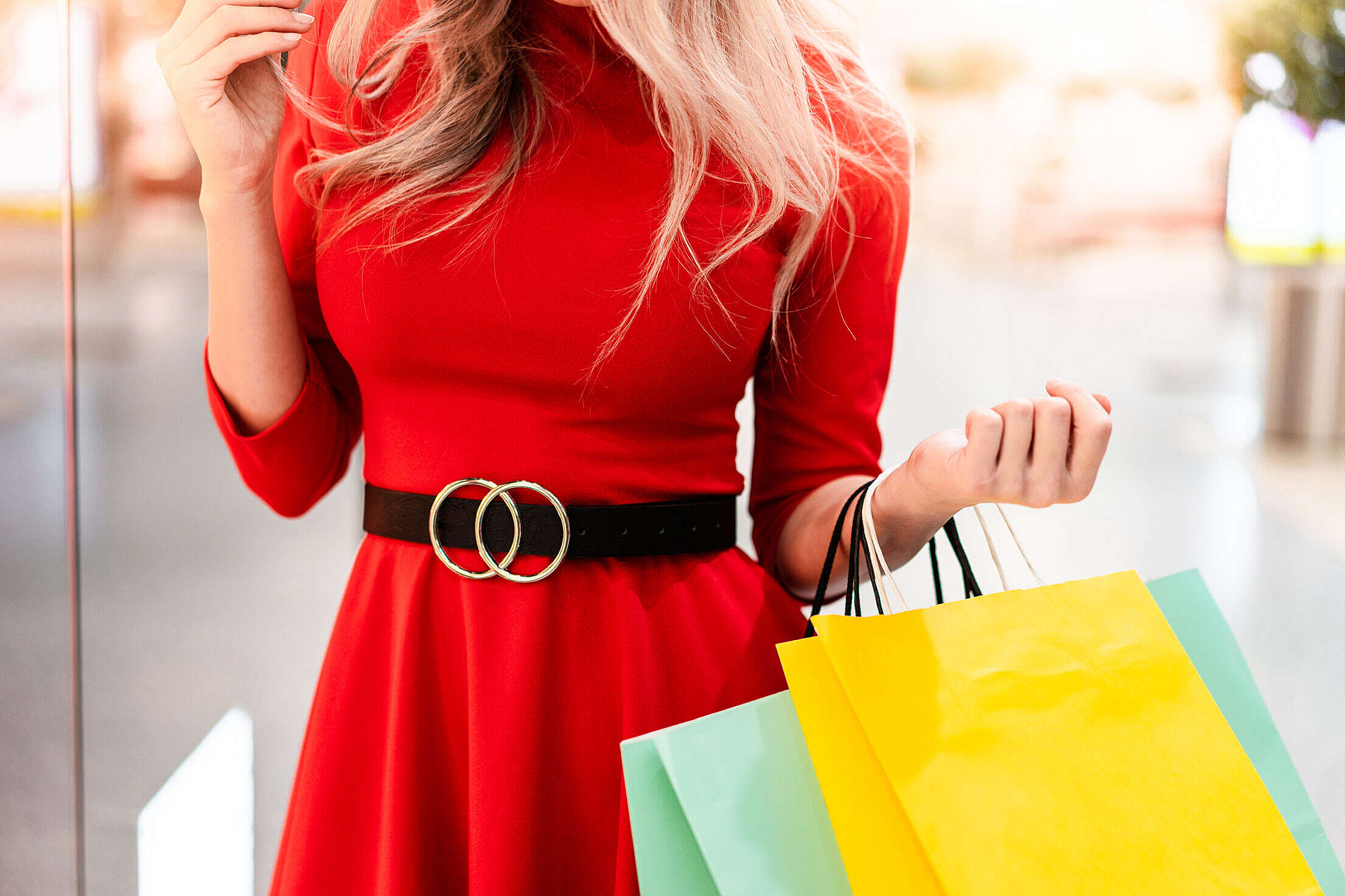 Well Dressed Woman in a Shopping Mall Free Stock Photo