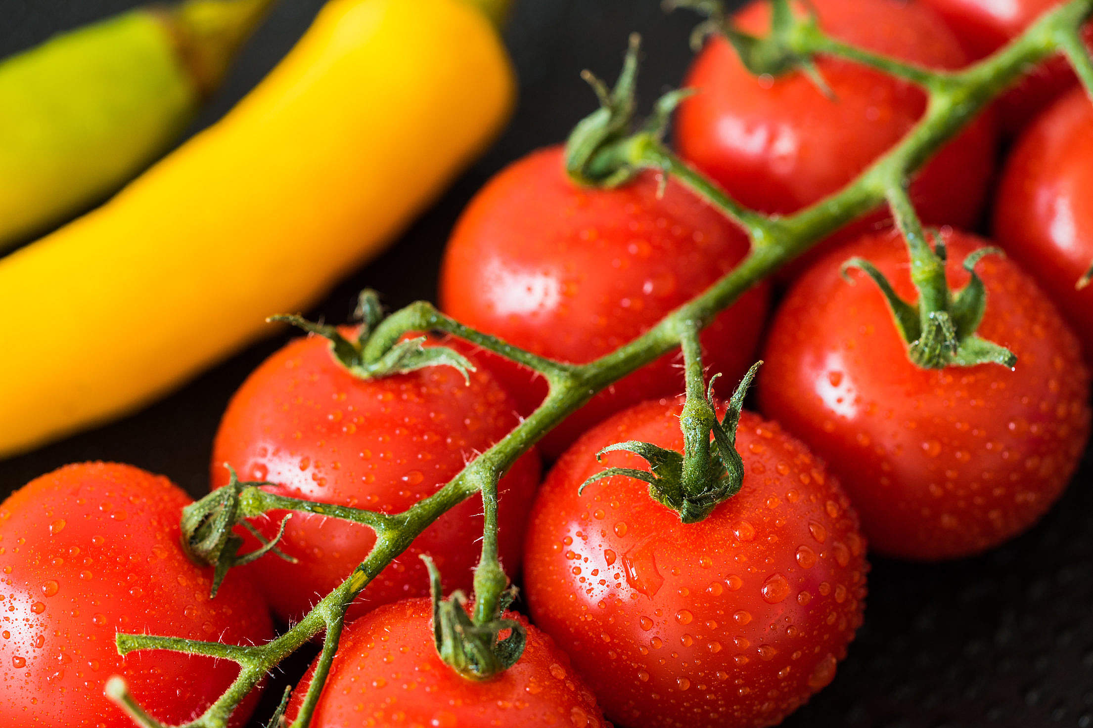 Wet Tomatoes and Peppers Close Up Free Stock Photo