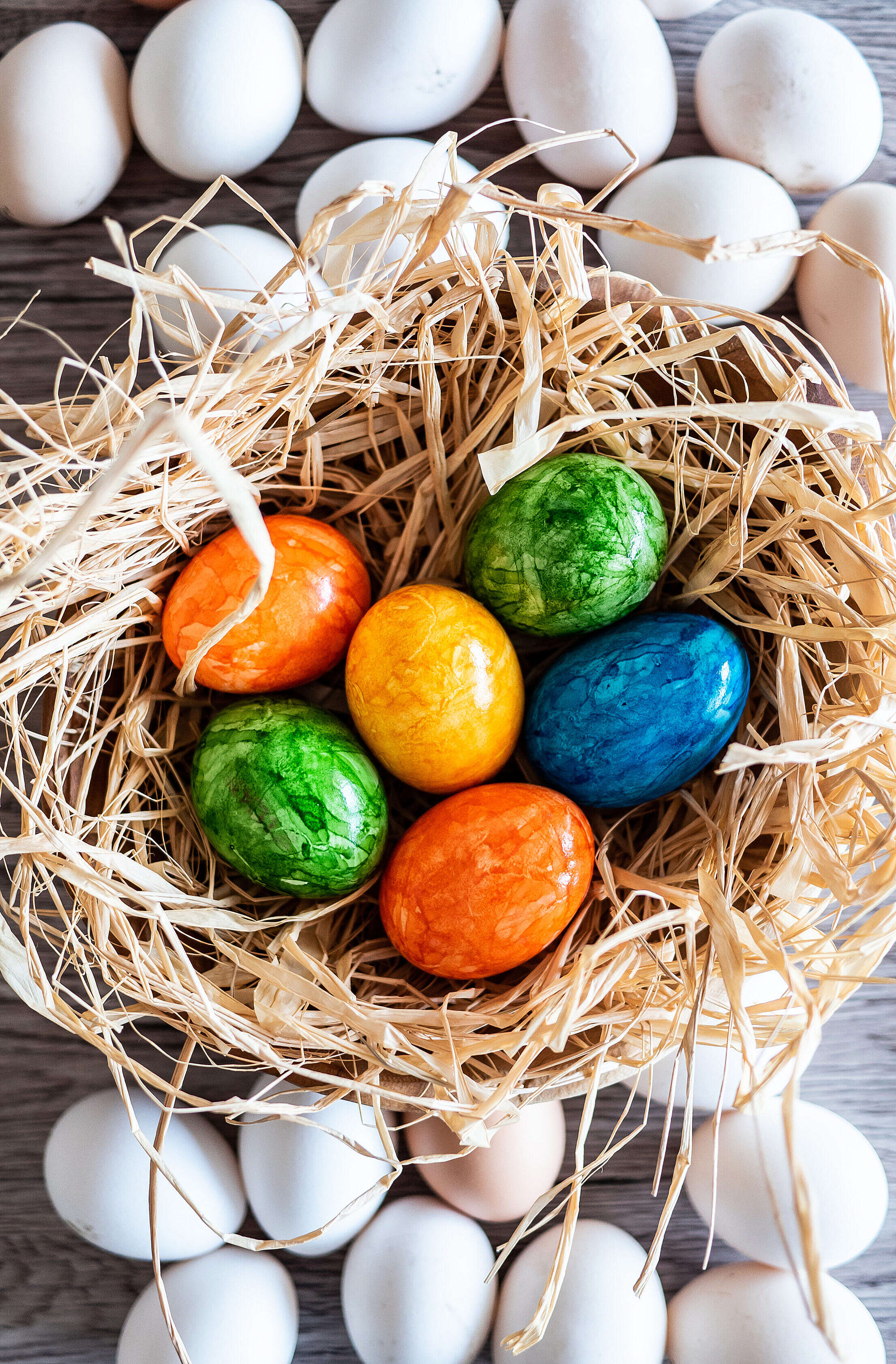 White Eggs and Colored Easter Eggs Vertical Free Stock Photo