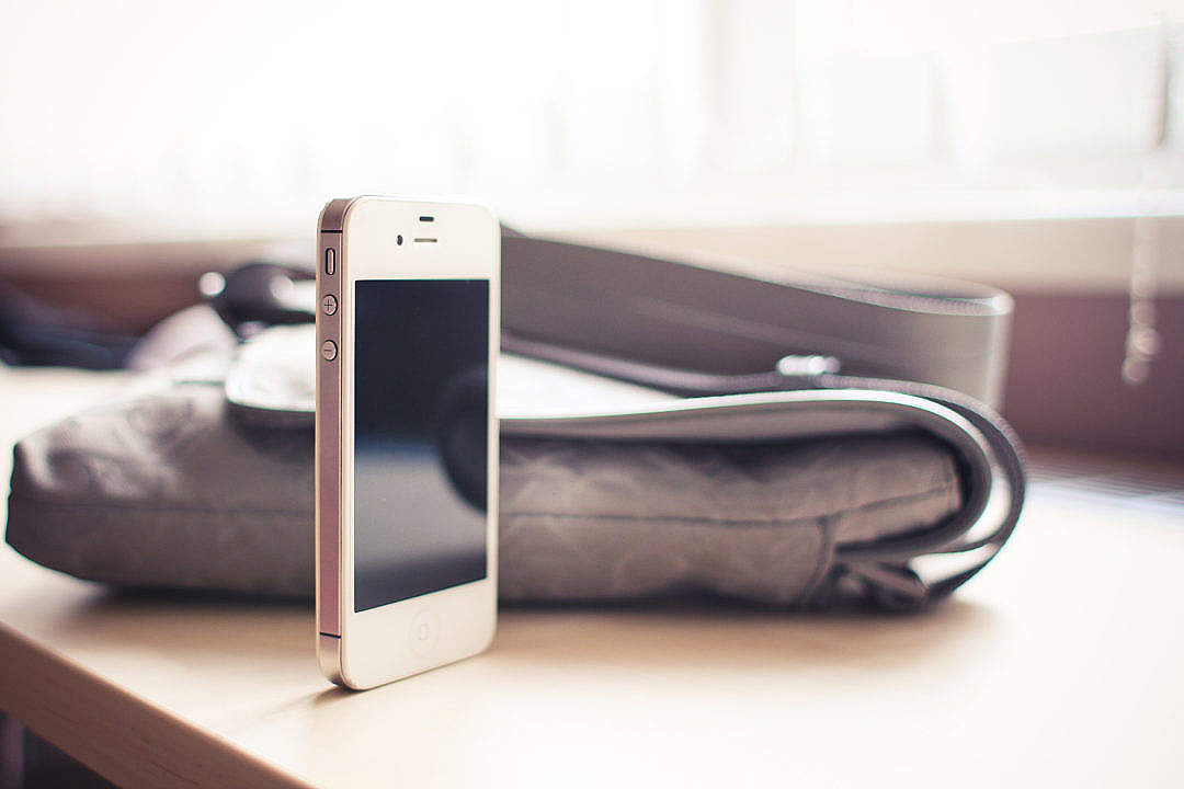 Download White iPhone 4S standing on the Desk FREE Stock Photo