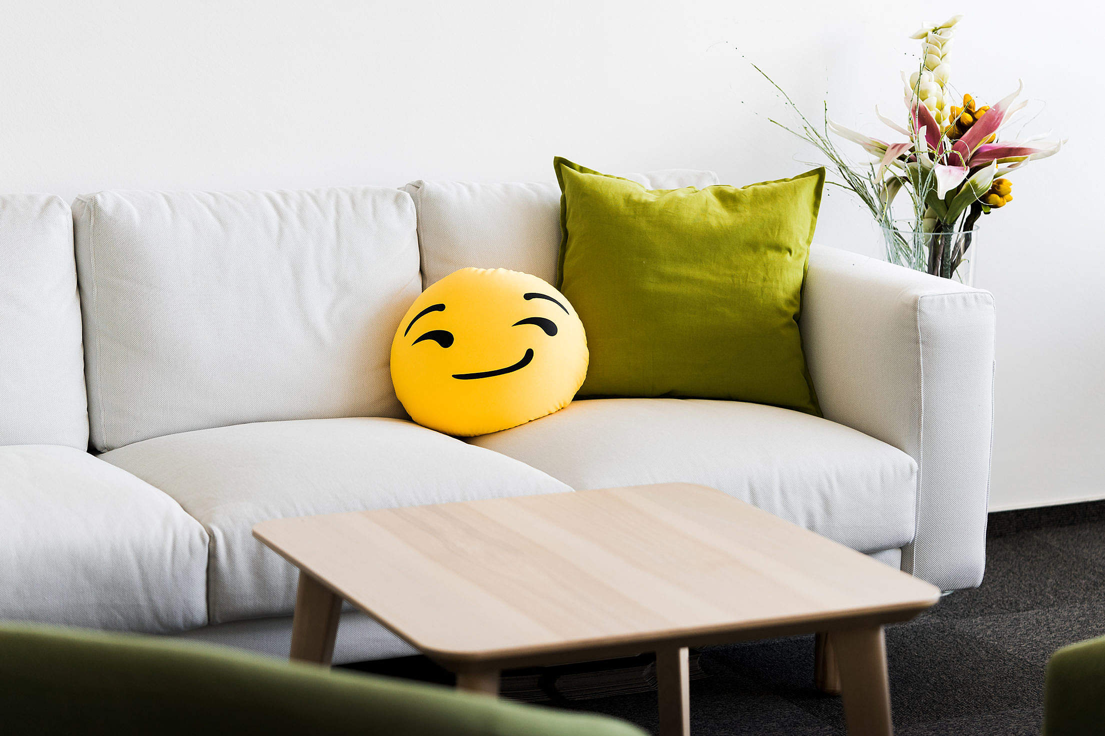 White Office Couch with Funny Emoji Pillow Free Stock Photo