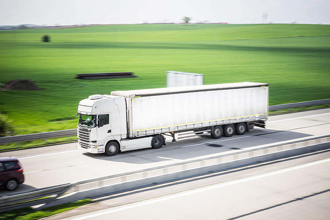 Download White TIR Truck in Motion Driving on Highway FREE Stock Photo