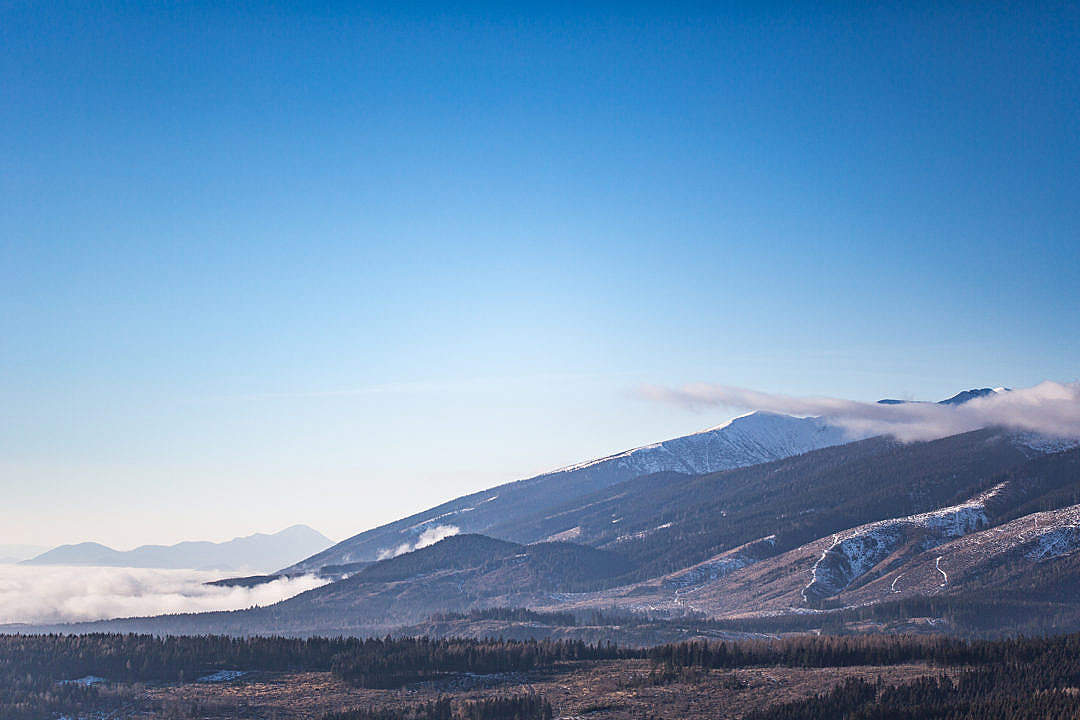 Download Winter Mountains and Bright Blue Sky FREE Stock Photo
