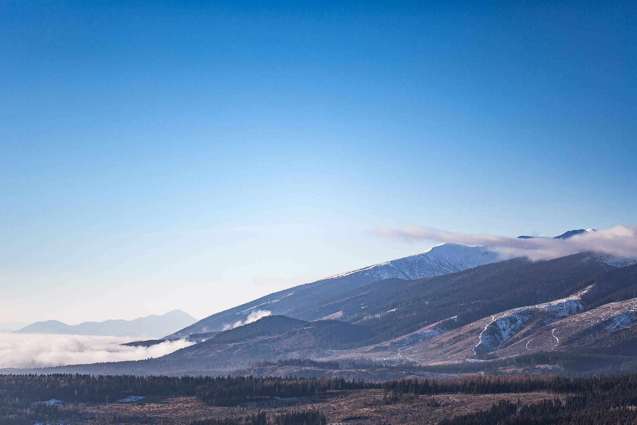 Winter Mountains and Bright Blue Sky Free Stock Photo