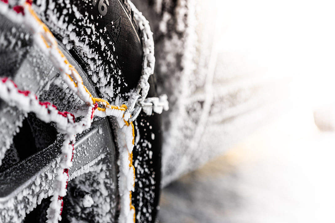 Download Winter Tyre with Snow Chains FREE Stock Photo