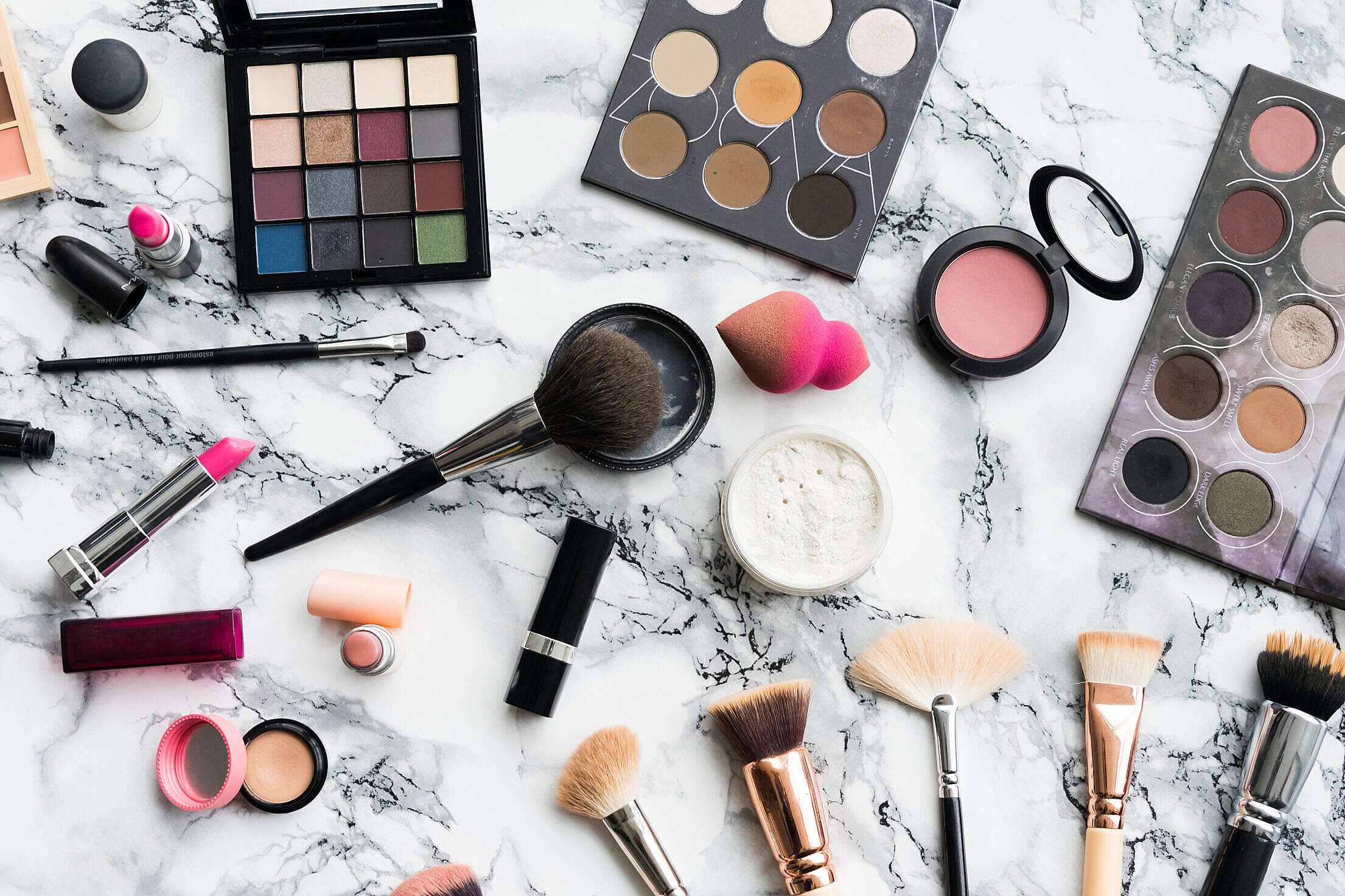 Woman Beauty Makeup Set on White Marble Background Free Stock Photo