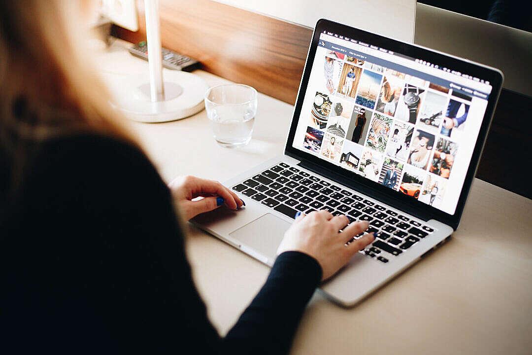 Download Woman Browsing Tumblr on Her Laptop FREE Stock Photo
