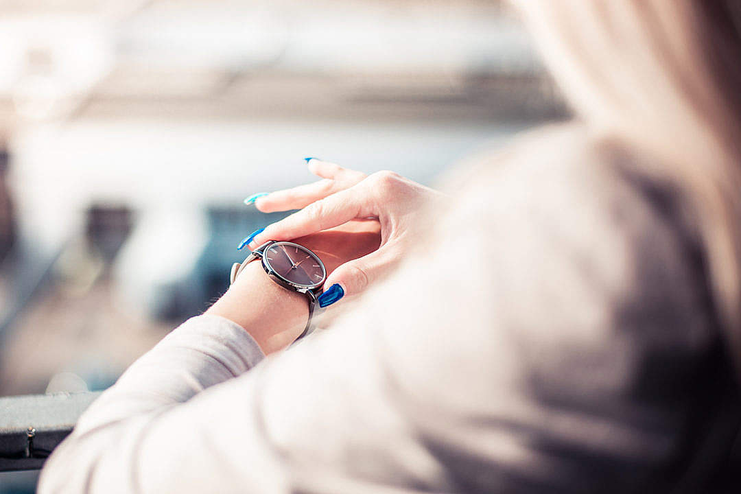 Download Woman Checking The Time on Her Fashion Watches FREE Stock Photo