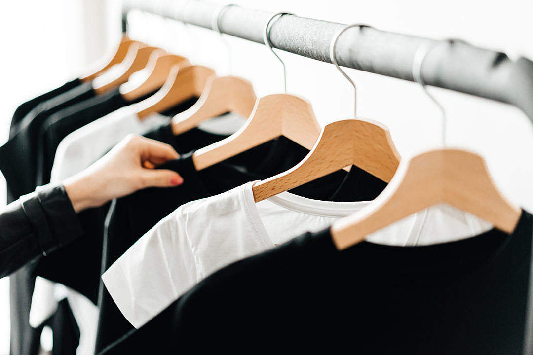 Download Woman Choosing T-Shirts During Clothing Shopping at Apparel Store #2 FREE Stock Photo