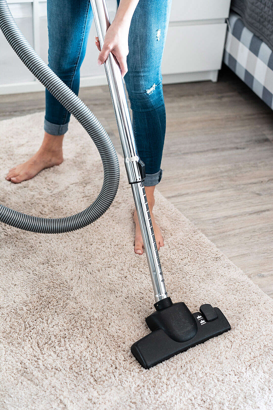 Download Woman Cleaning Vacuuming the Carpet at Home FREE Stock Photo