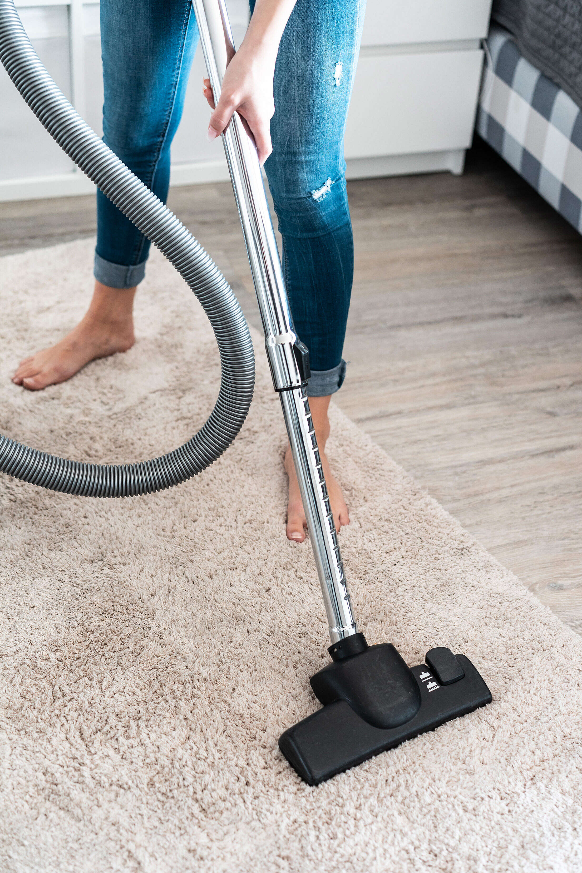 Woman Cleaning Vacuuming the Carpet at Home Free Stock Photo