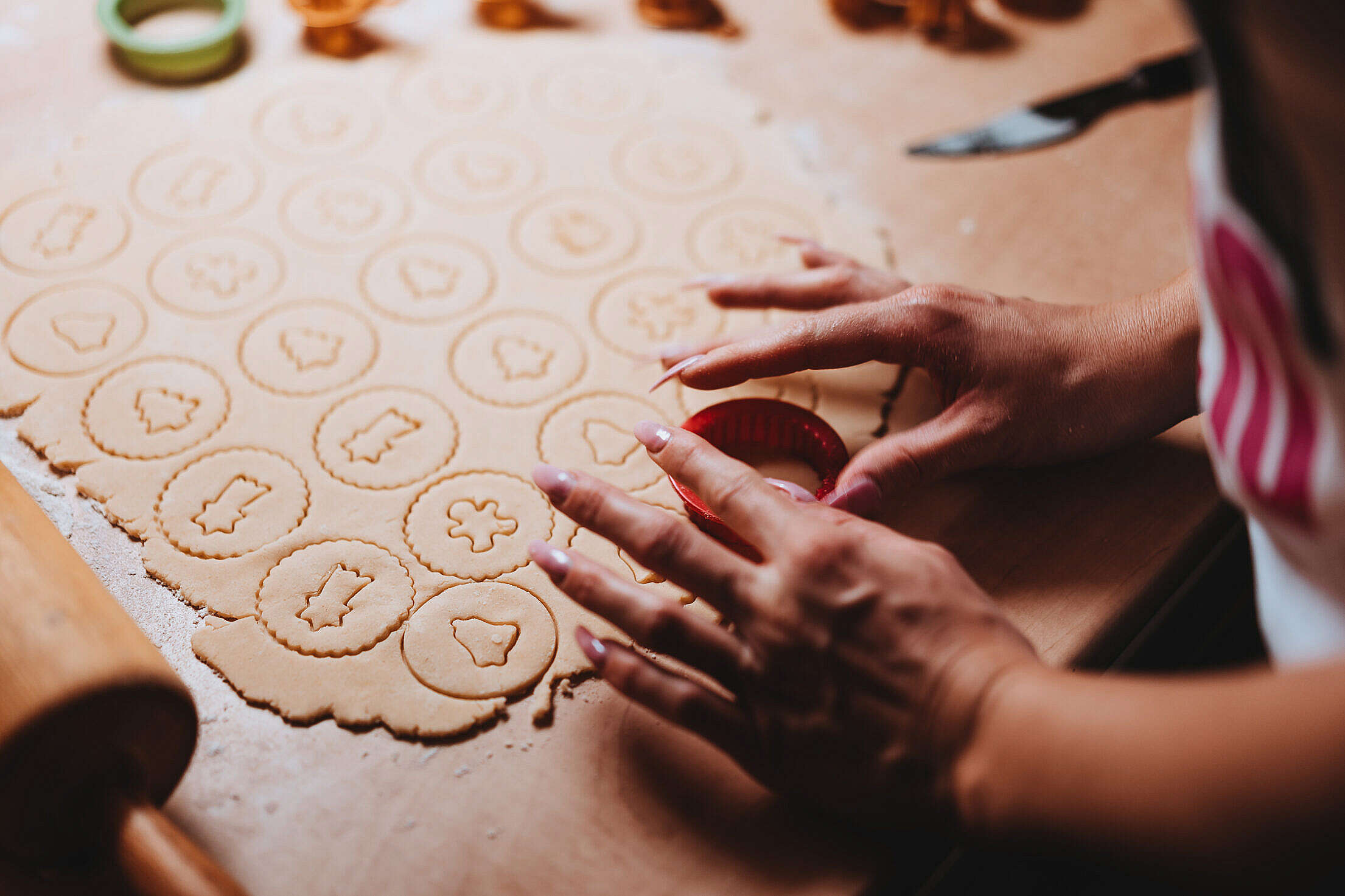 Woman Cutting Out Christmas Cookies Free Stock Photo