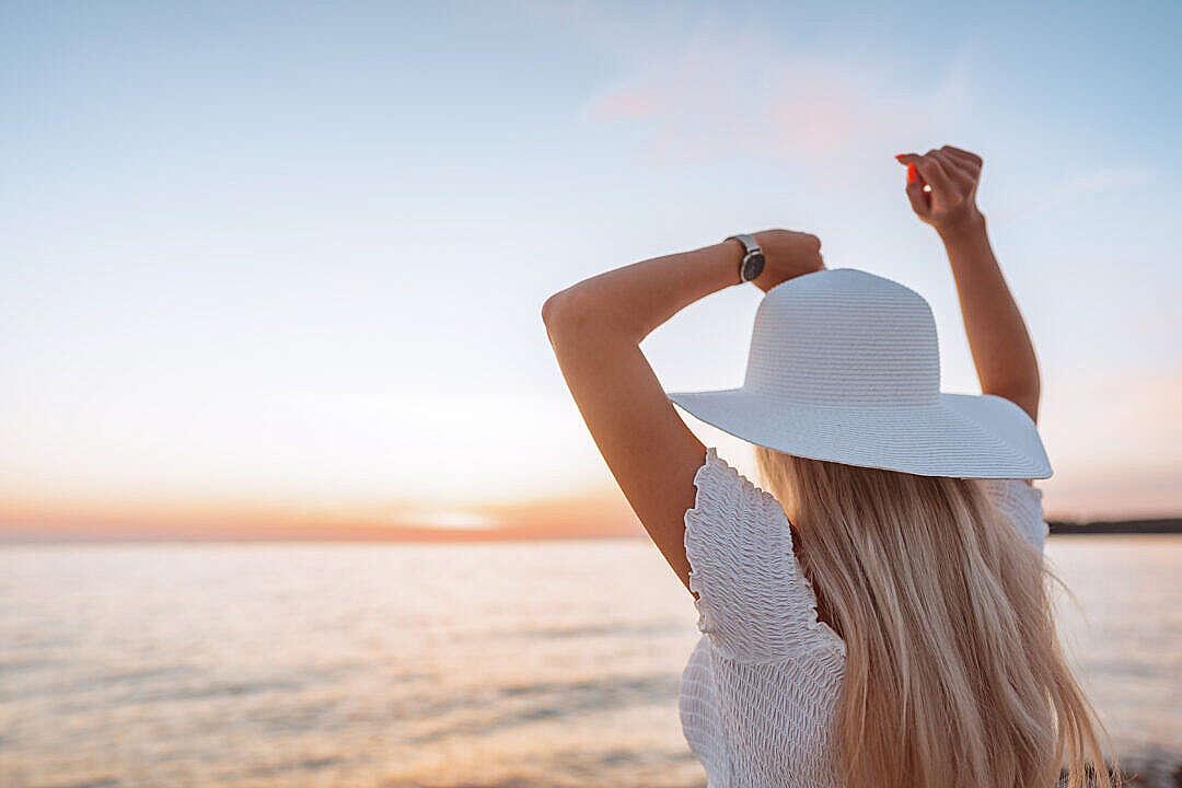 Download Woman Dancing and Enjoying Beautiful Sunset FREE Stock Photo