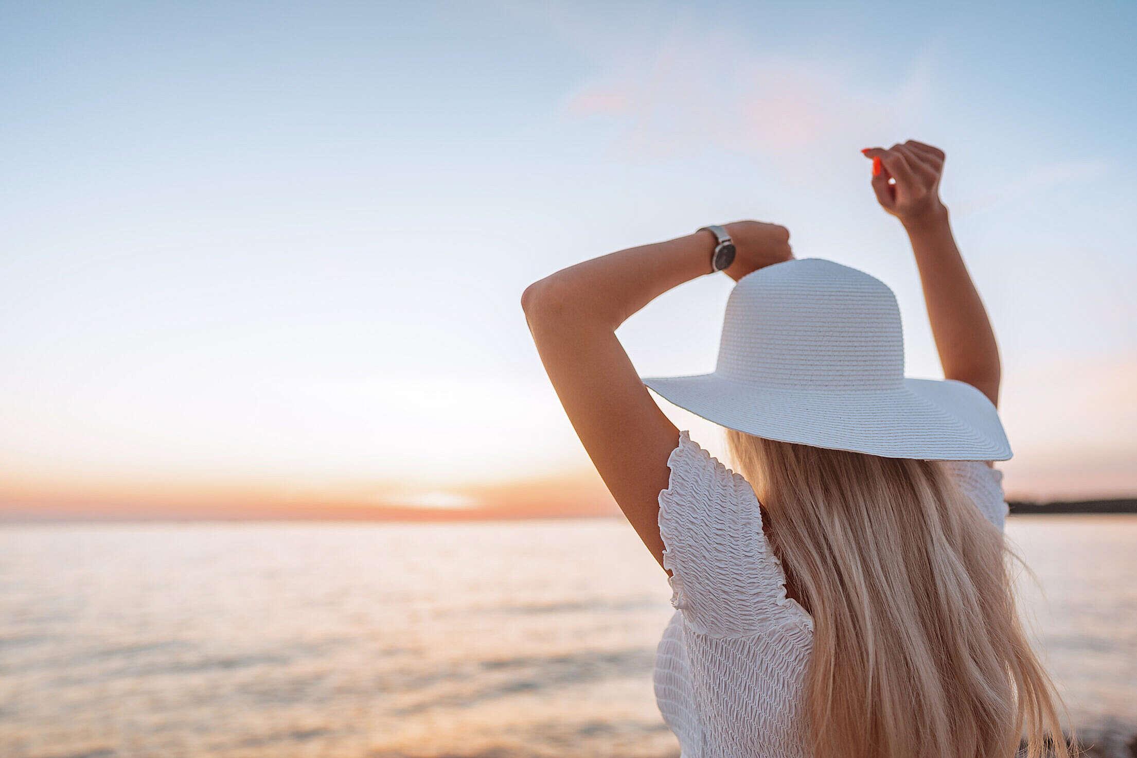 Woman Dancing and Enjoying Beautiful Sunset Free Stock Photo