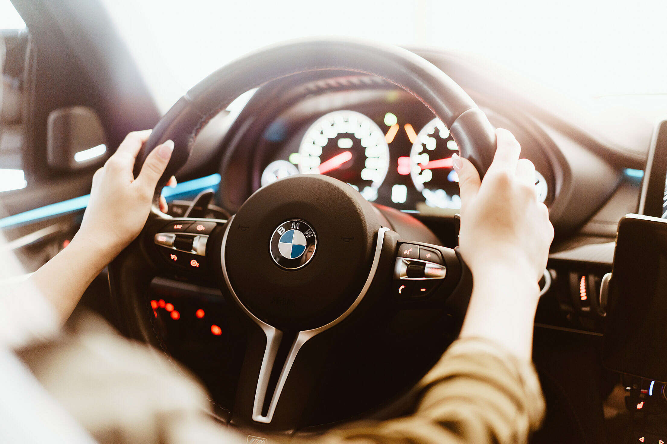 Woman Driving a BMW Luxury Car Free Stock Photo