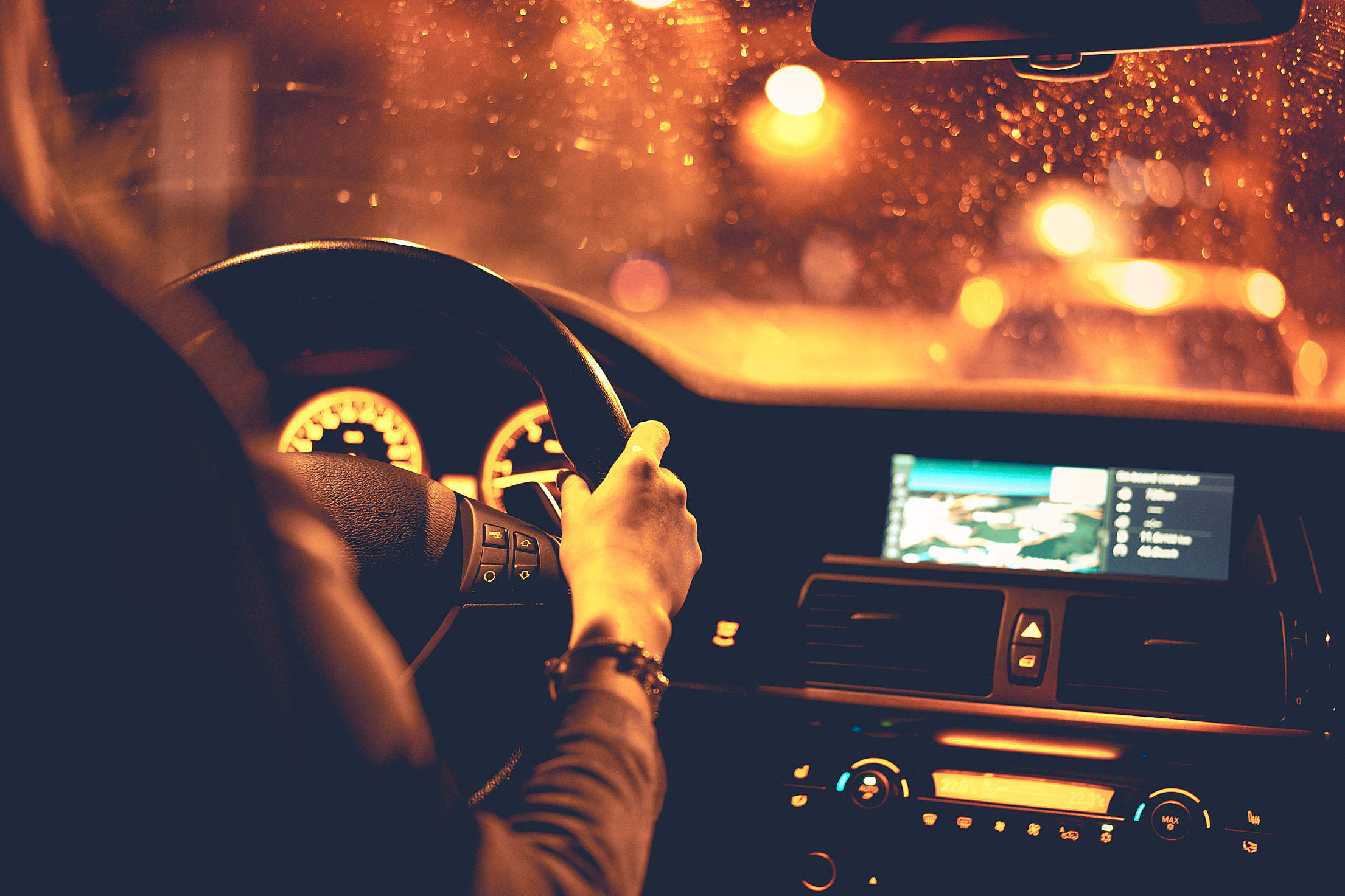 Woman Driving at Night Free Stock Photo