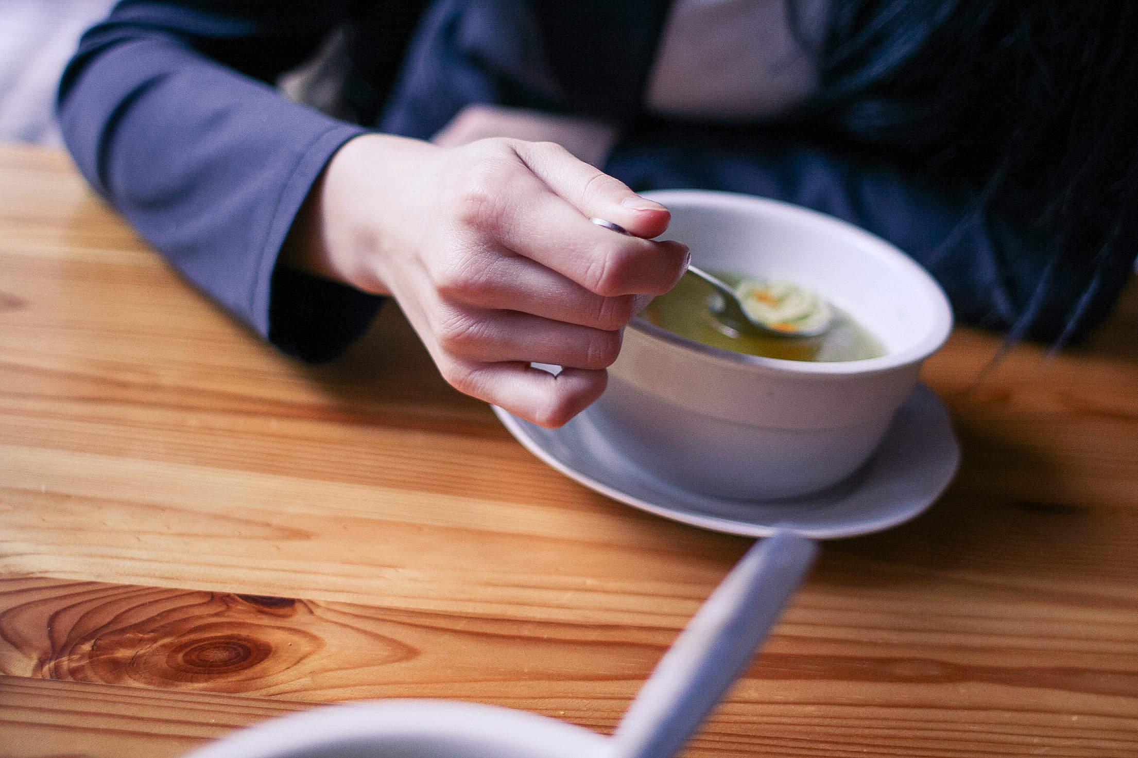 Woman Eating a Soup Free Stock Photo