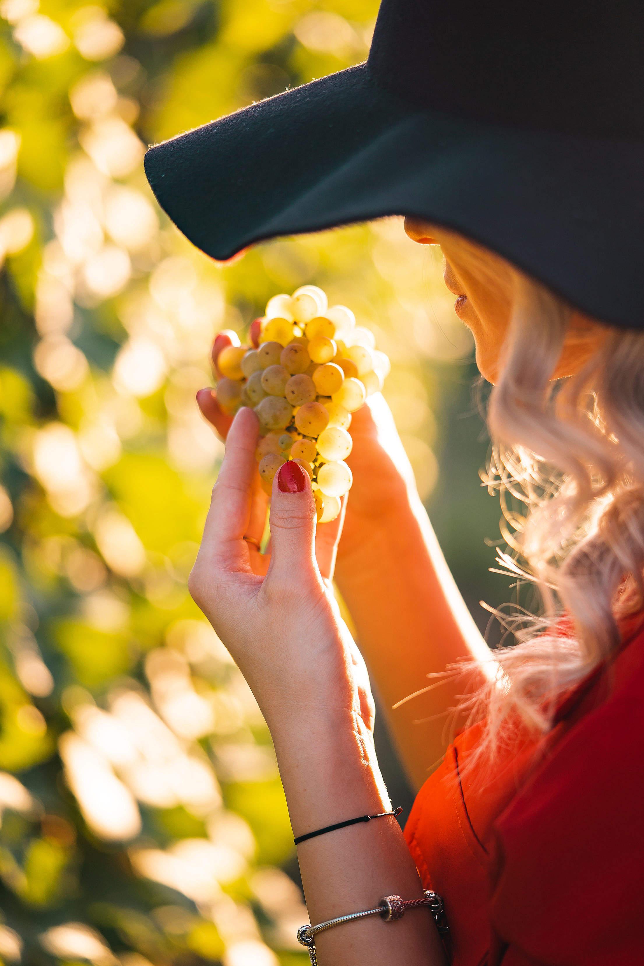 Woman Eating Grapes Free Stock Photo