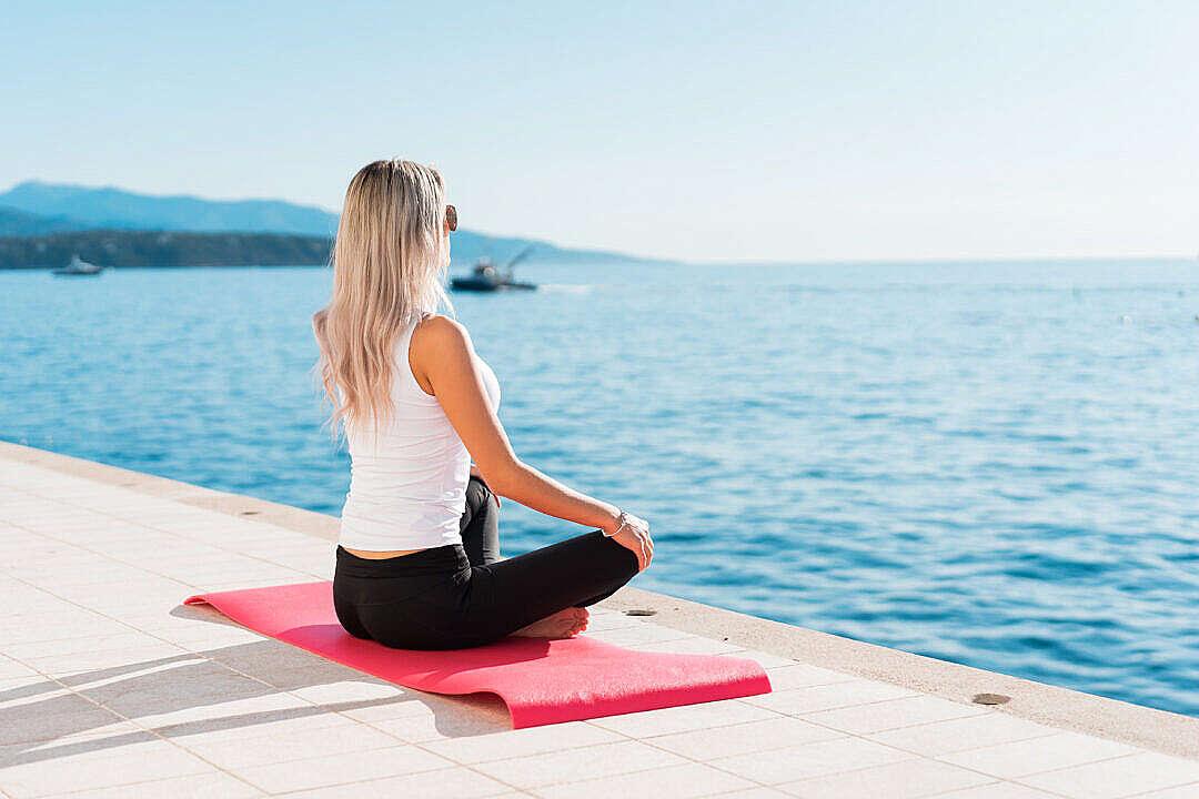 Download Woman Enjoying Sun During Morning Yoga FREE Stock Photo