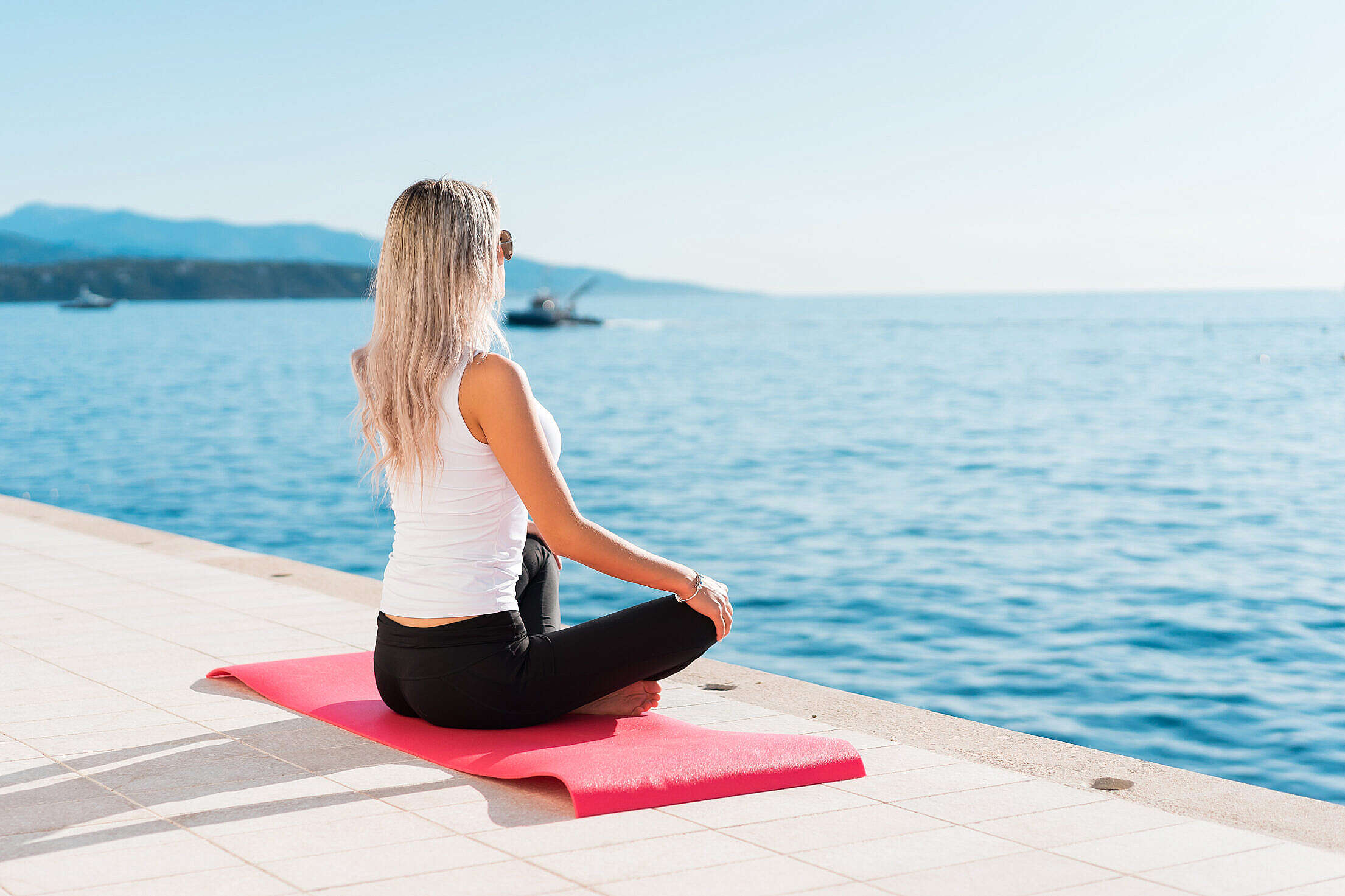 Woman Enjoying Sun During Morning Yoga Free Stock Photo