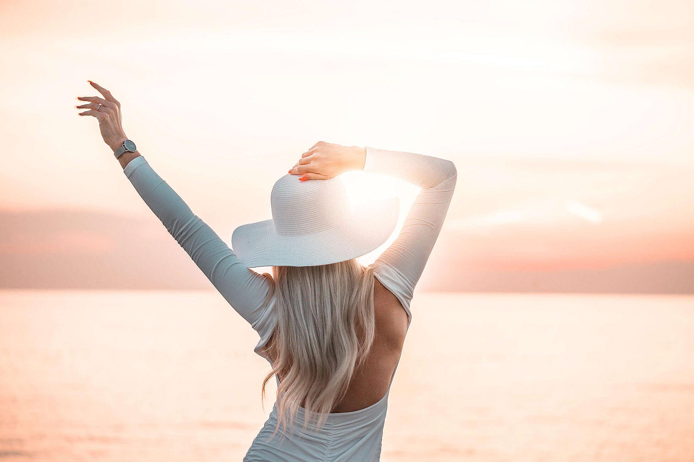 Woman Enjoying the Sunset by the Sea Free Stock Photo