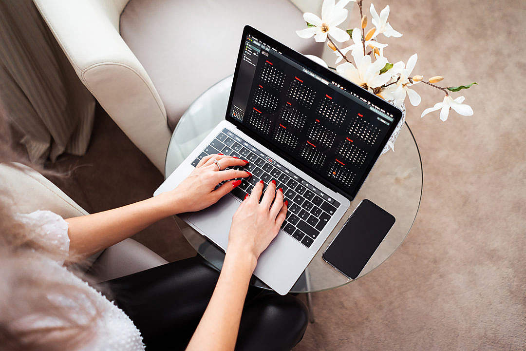 Download Woman Entrepreneur Working on Her Modern Laptop FREE Stock Photo