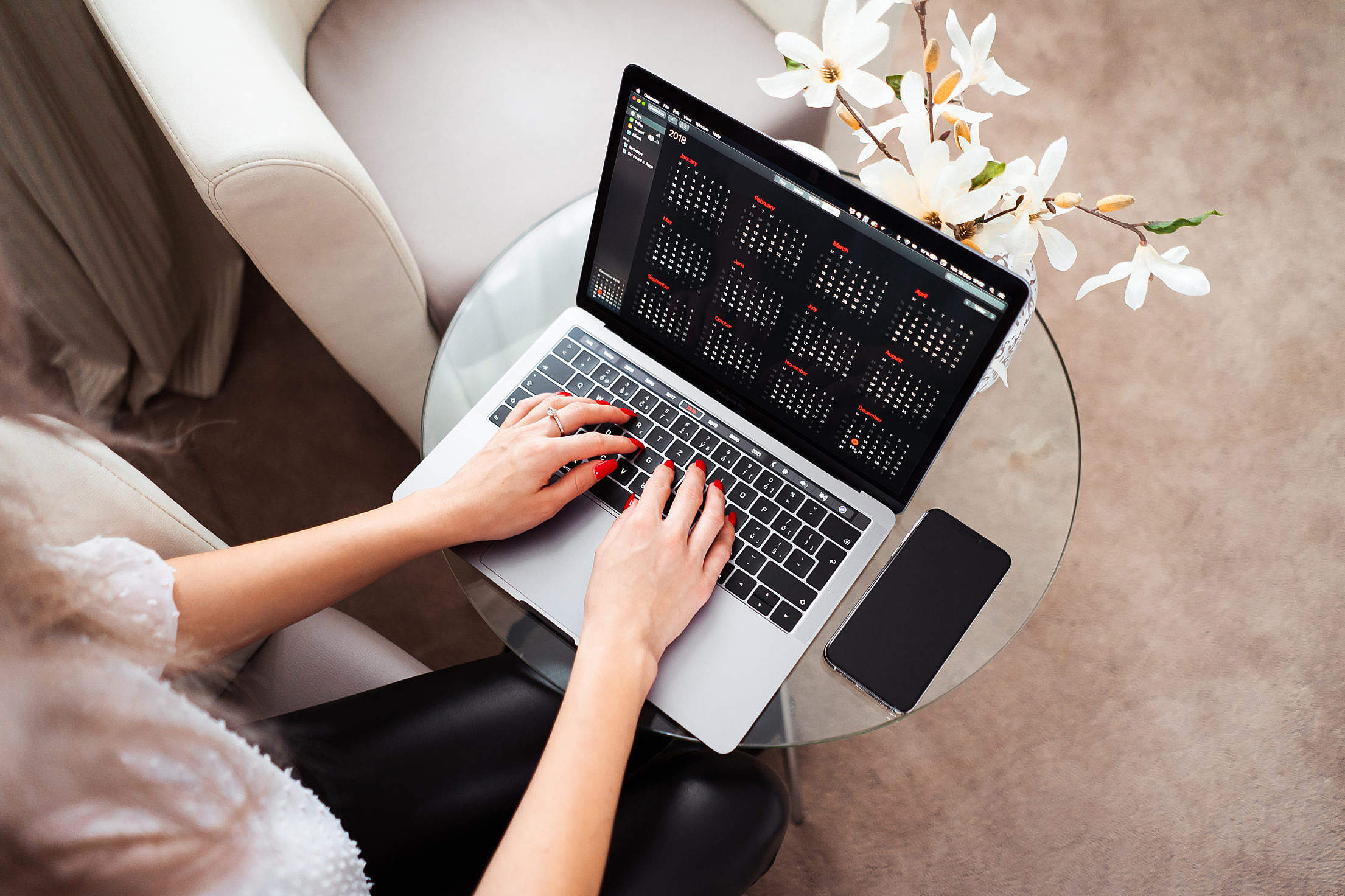 Woman Entrepreneur Working on Her Modern Laptop Free Stock Photo