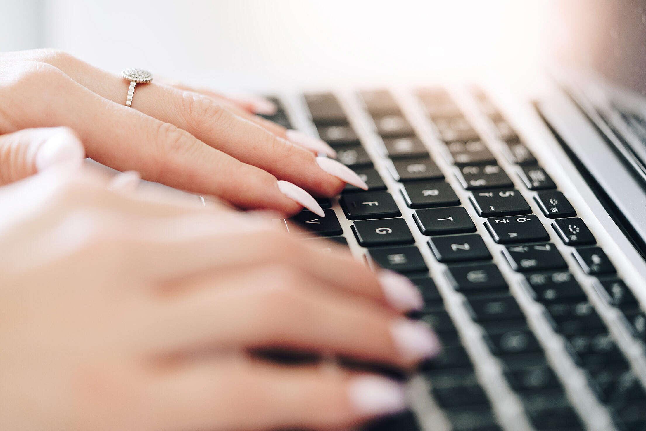 Woman Entrepreneur Working on Laptop Close Up Free Stock Photo
