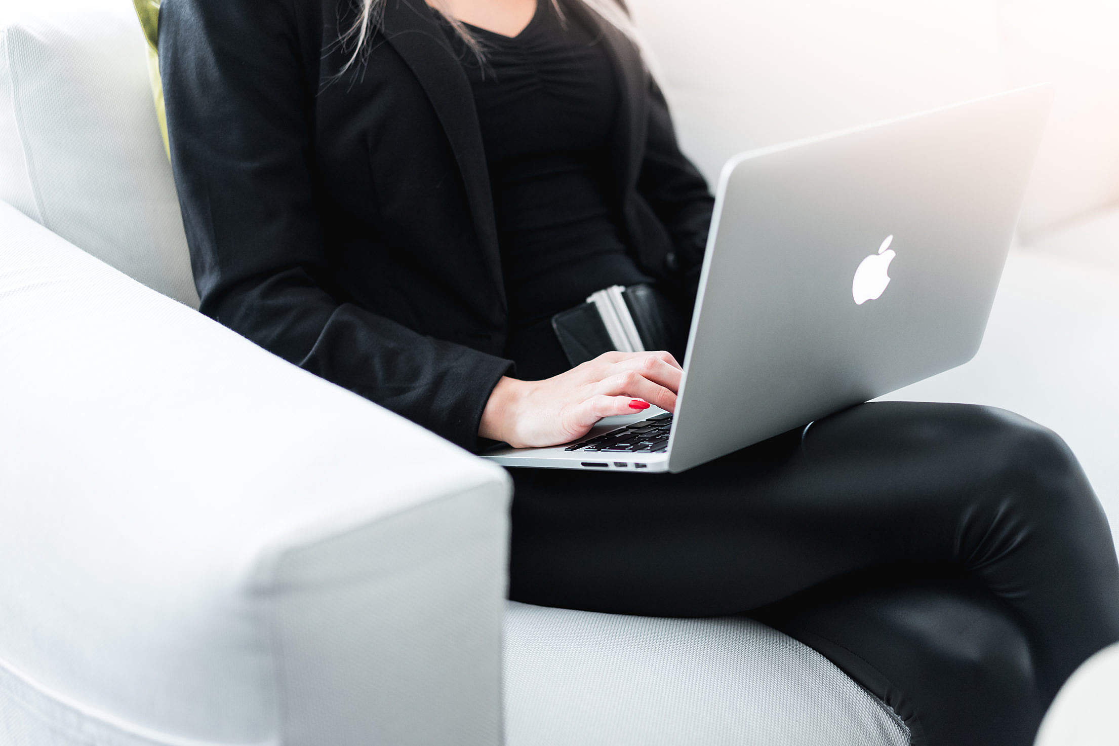Woman Entrepreneur Working on Silver Laptop Free Stock Photo