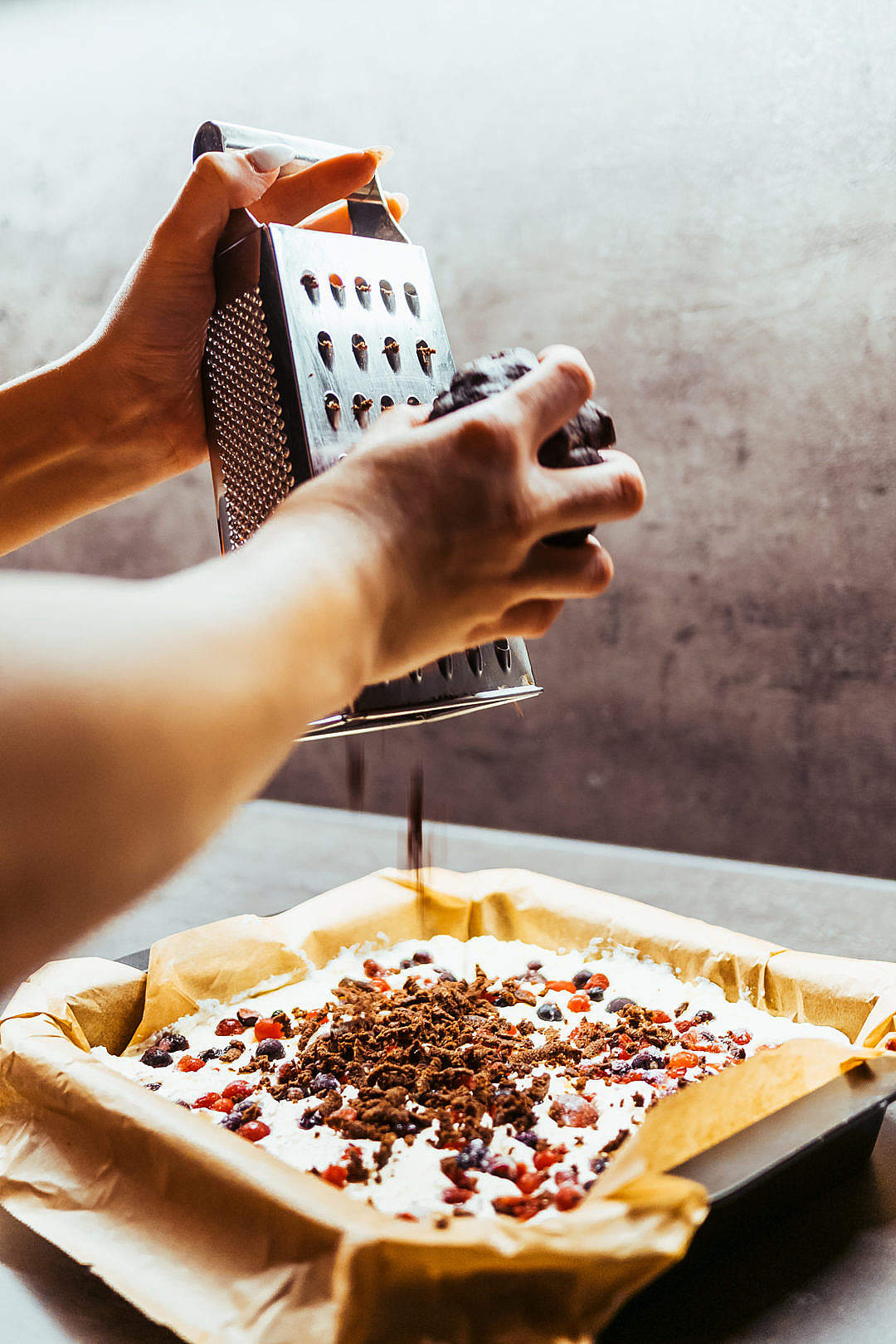 Download Woman Grating Chocolate on a Cake FREE Stock Photo