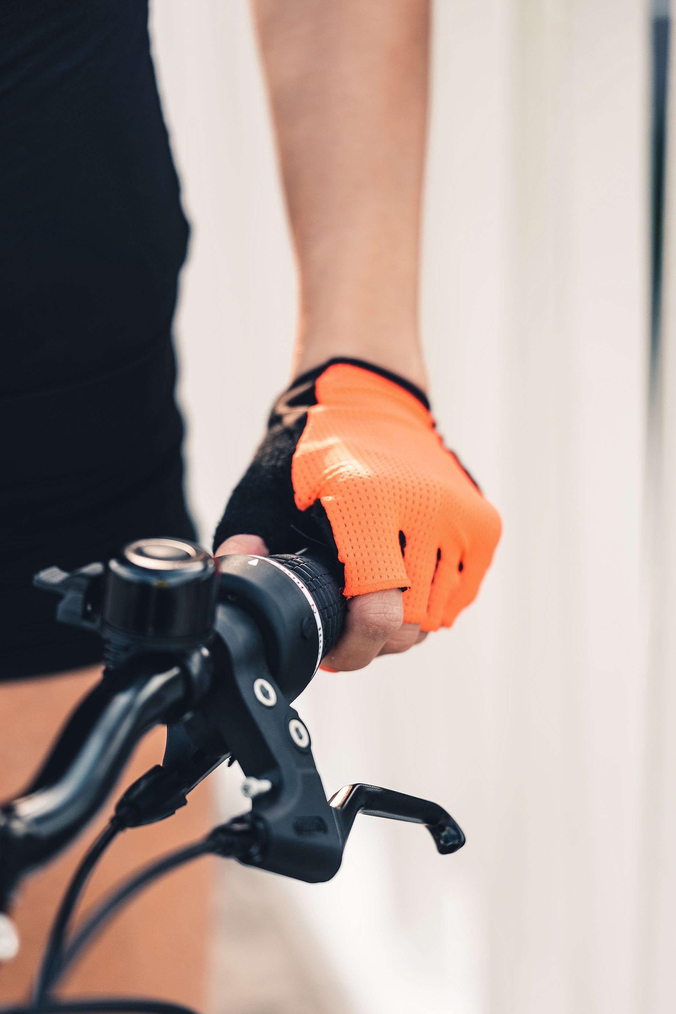 Woman Holding a Bicycle Handlebar Free Stock Photo