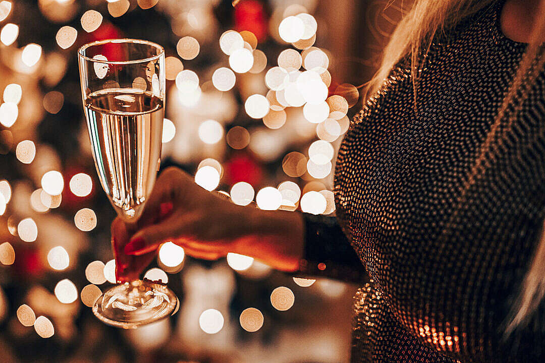 Download Woman Holding a Champagne Glass with Prosecco FREE Stock Photo