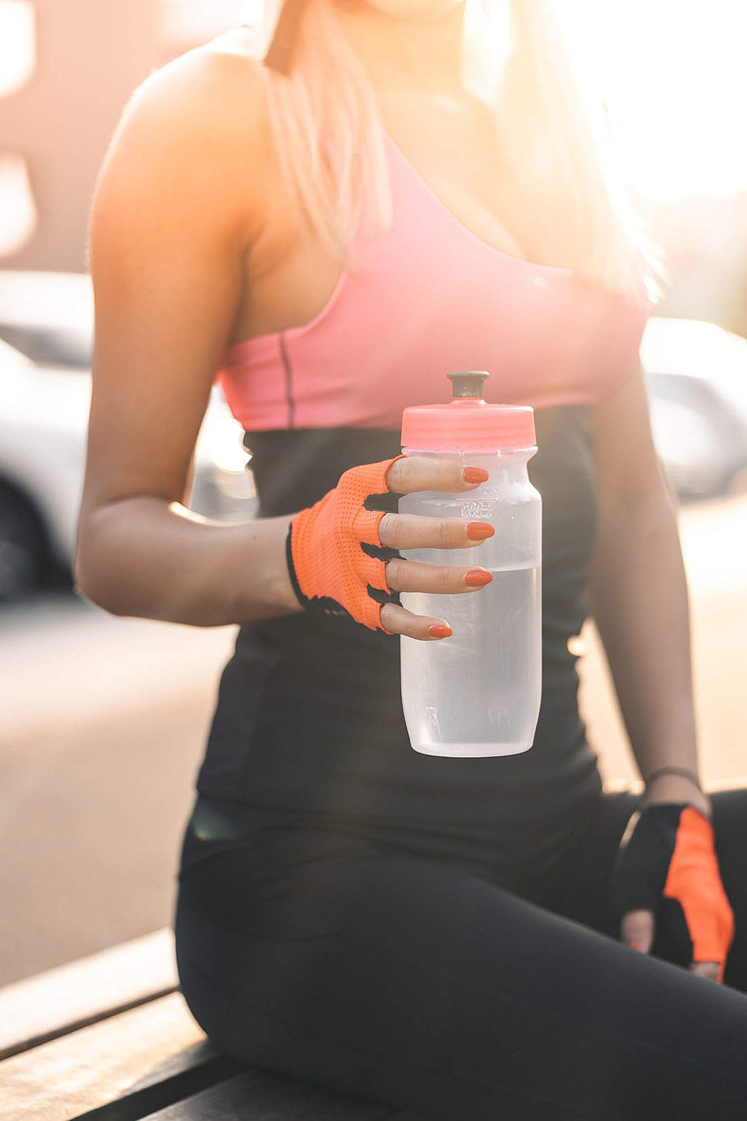 Download Woman Holding a Sports Bottle FREE Stock Photo
