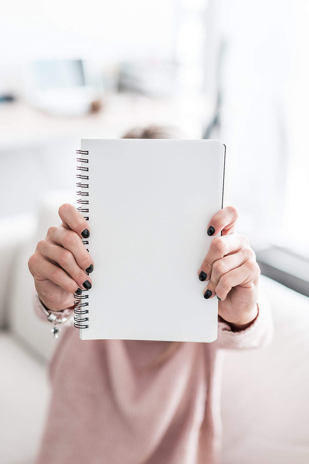Download Woman Holding Blank Notebook FREE Stock Photo