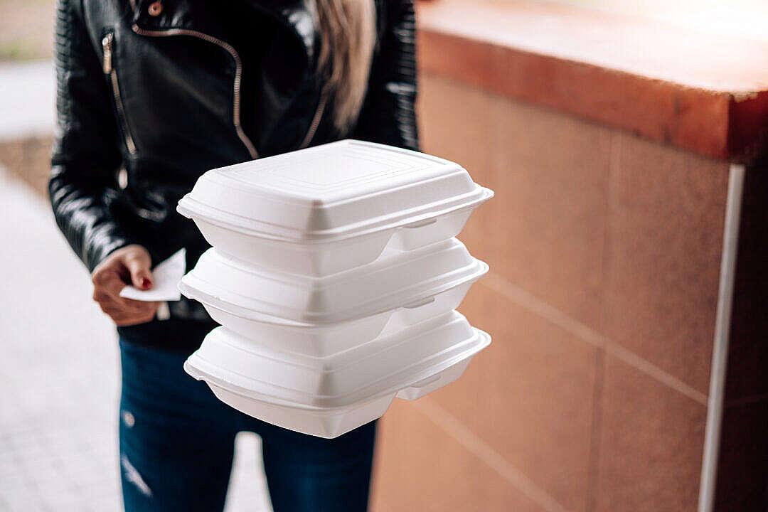 Download Woman Holding Boxes with Food FREE Stock Photo