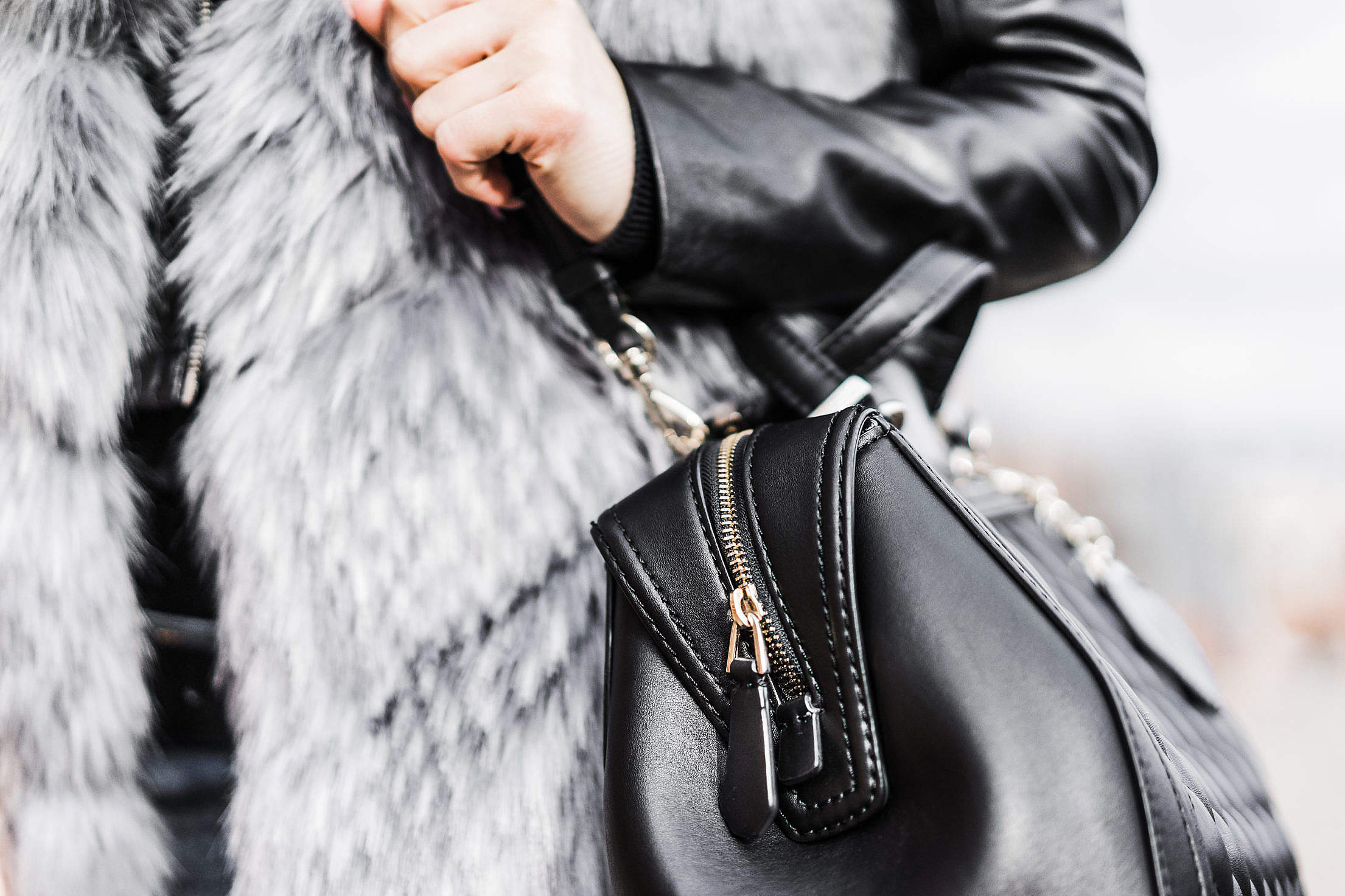 Download Woman Holding Her Black Leather Bag Close Up Free Stock Photo