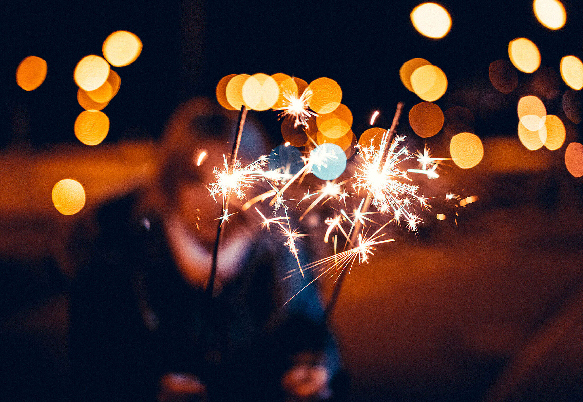 Woman Holding Sparklers in Hands Free Stock Photo